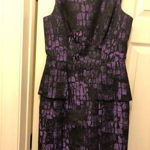 Purple cocktail dress with peplum